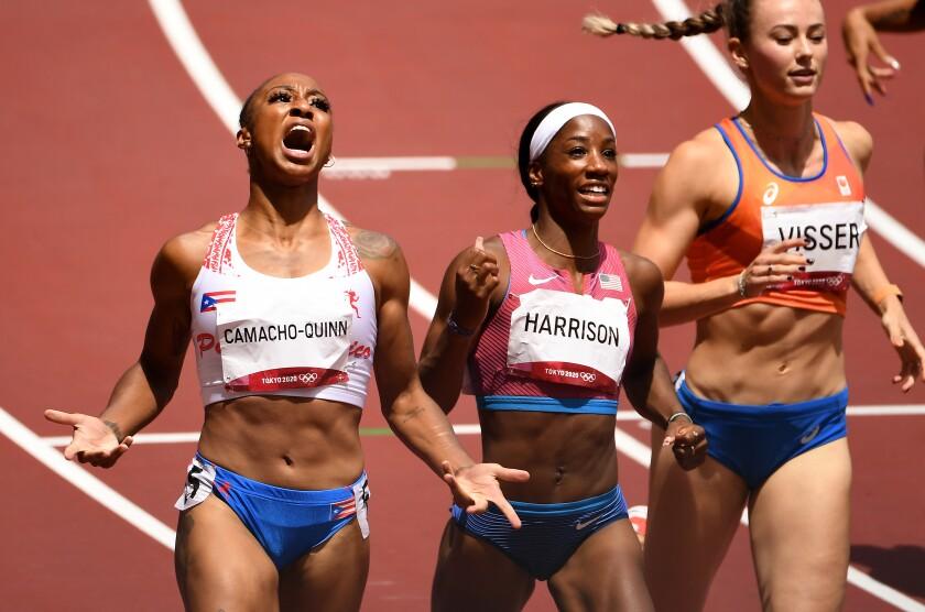 Jasmine Camacho-Quinn celebrates her win in the women's 100-meter hurdles at the Tokyo Olympics.