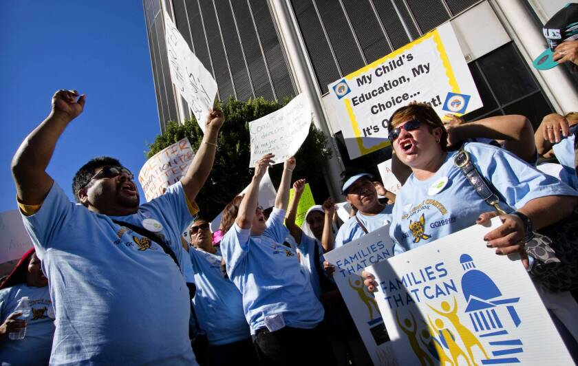 Charter school advocates hold a rally in front of LAUSD headquarters in downtown Los Angeles on Tuesday.