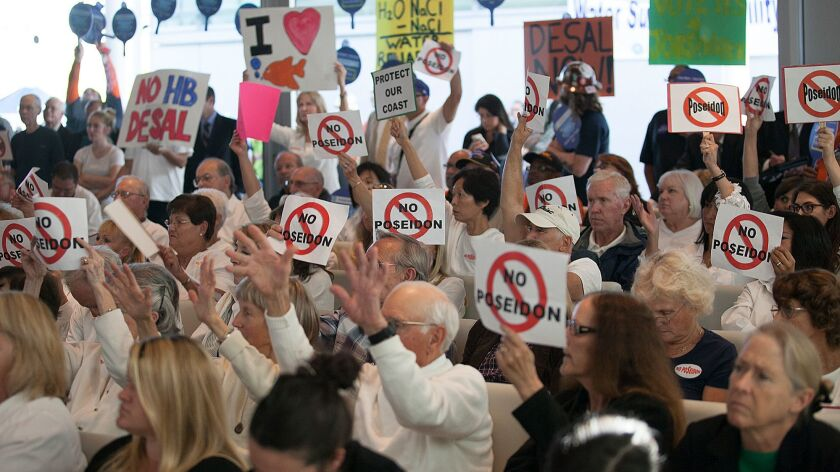 Protestors against the proposed Huntington Beach desalination plant pack a 2013 Coastal Commission meeting in Newport Beach.