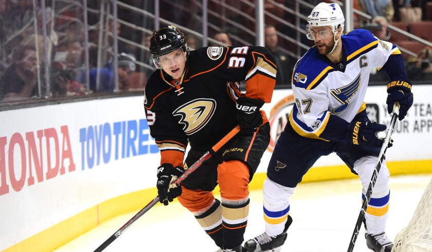 Ducks' Jakob Silfverberg (33) looks to pass as he is chased by St. Louis Blues' Alex Pietrangelo during the first period on Sunday.