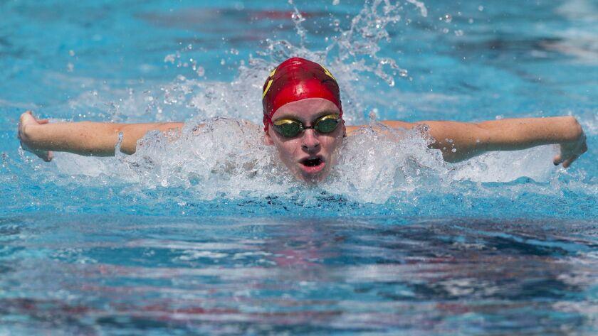 Mt. Carmel's Julianna Fox swims the 100 yard butterfly, winning the championship heat.