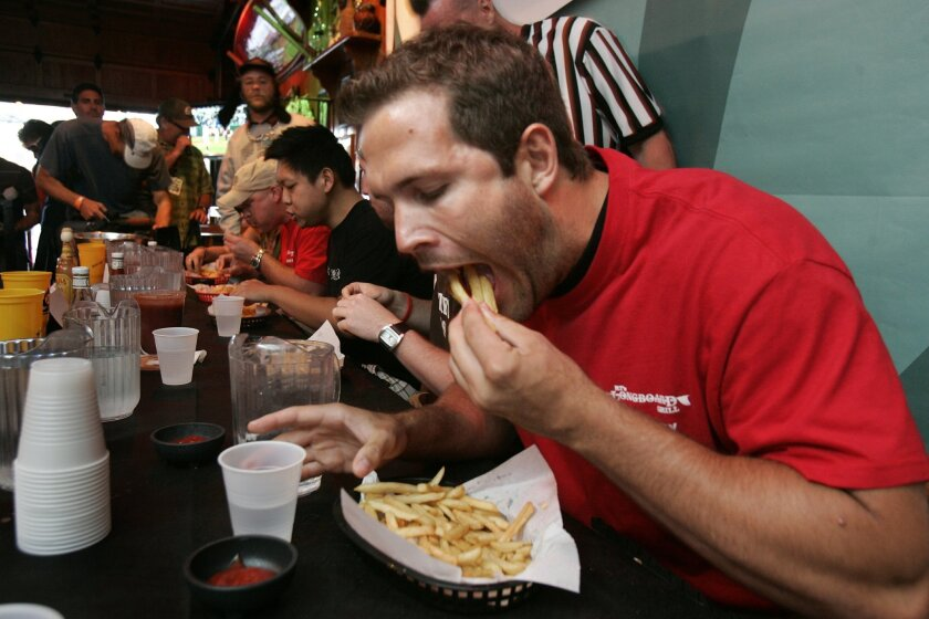 A french fry-eating contest at RT's Longboard Grill in Pacific Beach.