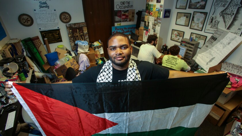 Robert Gardner, a senior at UCLA, stands in the Students for Justice in Palestine office.