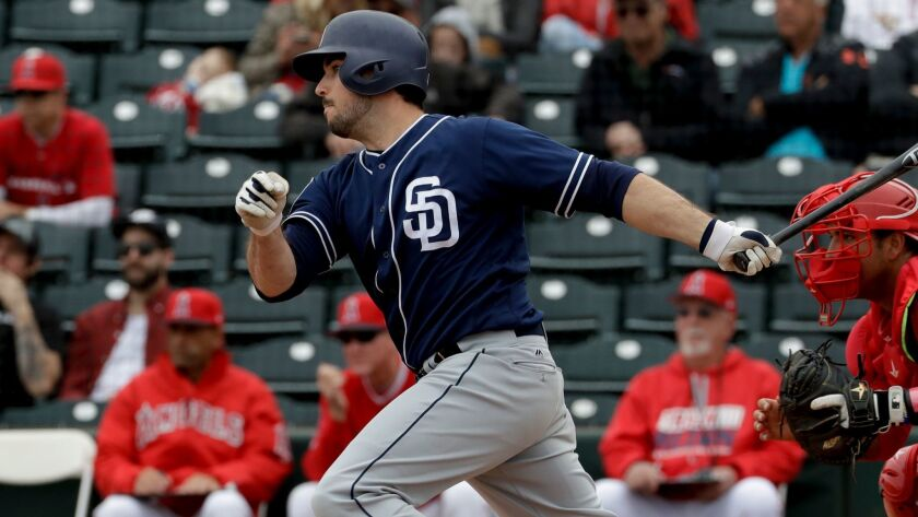 San Diego Padres' Austin Hedges watches his RBI-single against the Los Angeles Angels during the sec