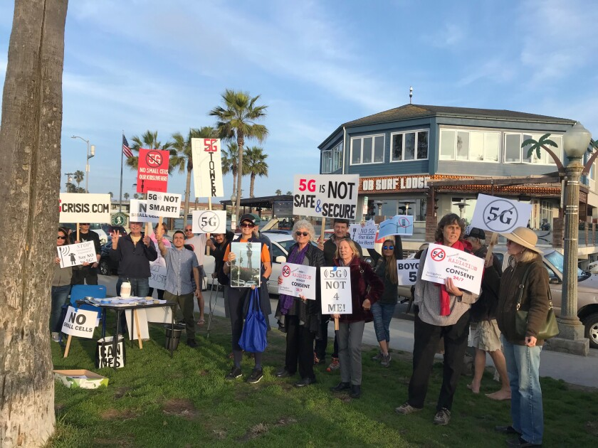Citizens gather to protest 5G tower installations.