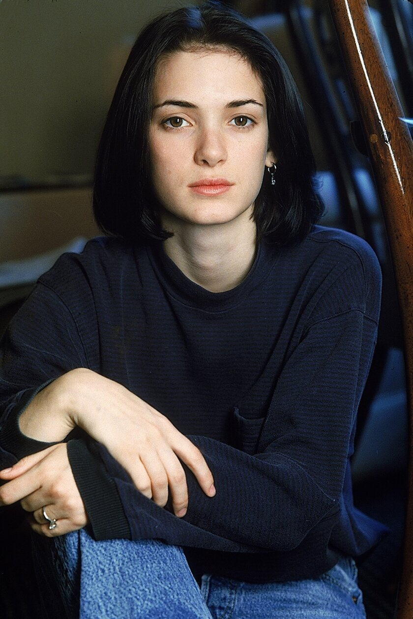 """FILE - This Dec. 1989 file photo shows actress Winona Ryder, 19, poses during an interview in New York. The 1988 film """"Heathers"""" starring Ryder, Shannen Doherty and Christian Slater has been turned a show by Tony Award nominee Laurence O'Keefe and Emmy Award winner Kevin Murphy. """"Heathers The Musical"""" will show up off-Broadway in March at New World Stages after a stint in Los Angeles. (AP Photo/Wyatt Counts, File)"""