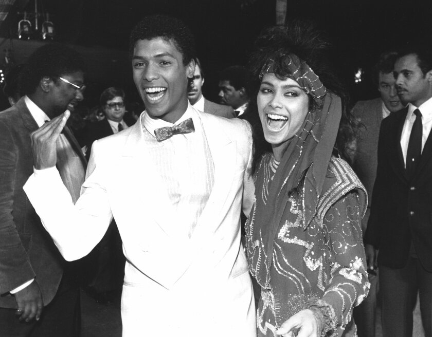"""FILE - In this March 22, 1985 file photo, actor Taimak, left, and Vanity arrive at the Century Plitt Theater for the premiere of their film """"The Last Dragon,"""" in Los Angeles. Vanity, a Prince protege who renounced her sexy stage persona to become a Christian minister, has died at age 57. The singer"""