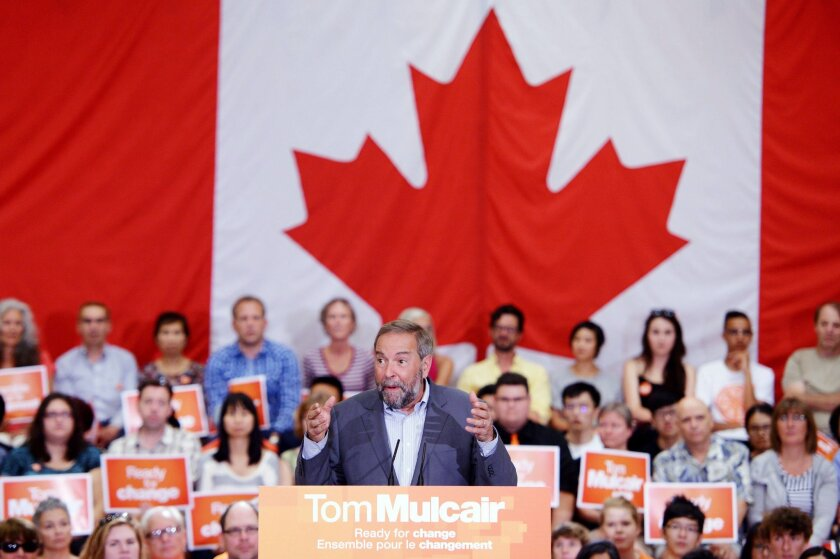 Tom Mulcair, the leader of Canada's New Democrats party, speaks to supporters at a campaign rally in Vancouver on Aug. 9.