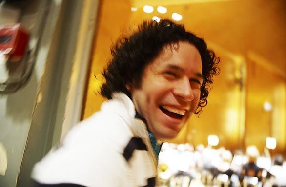 Gustavo Dudamel enjoys a light moment during a short fine-tuning session with the Swedish Gothenburg Symphony on May 29, 2009, just before the evening performance.