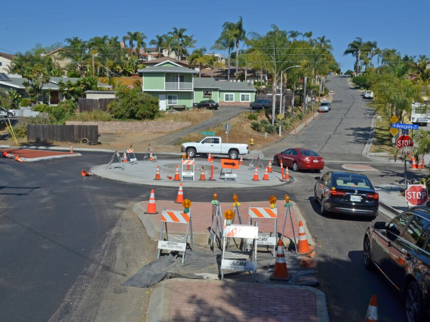 Vehicles navigate a new traffic circle at Mar Vista Drive, Avocado Drive and Presley Place Friday. City officials say the conditions that caused a school bus to get stuck there Wednesday have been alleviated.