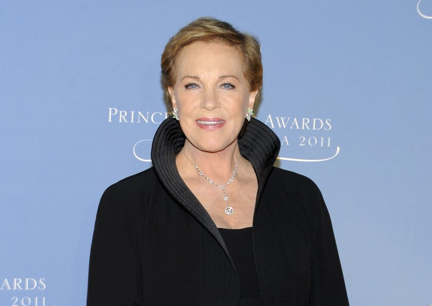 """FILE - This Nov. 1, 2011 file photo shows honoree Julie Andrews attending the Princess Grace Foundation Awards gala in New York. Andrews released a memoir, """"Home Work: A Memoir of My Hollywood Years,"""" which hits shelves on Oct. 15, 2019. (AP Photo/Evan Agostini, File)"""