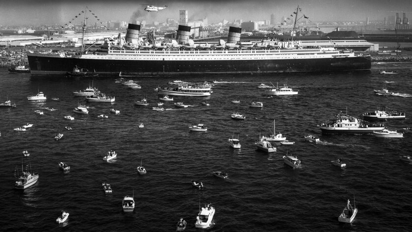 Dec. 9, 1967: A fleet of small craft join in the celebration as the 81,000 ton Queen Mary arrives in