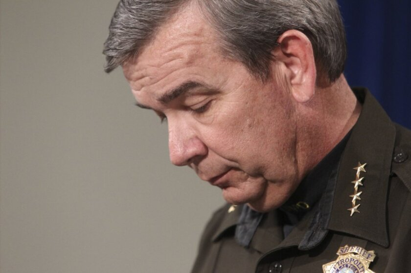 Sheriff Doug Gillespie speaks during a news conference at Las Vegas Metropolitan Police headquarters in Las Vegas Monday, Jan. 21, 2013. Authorities say a Las Vegas police lieutenant and two family members are dead in an apparent double murder and suicide in Boulder City, Nev.