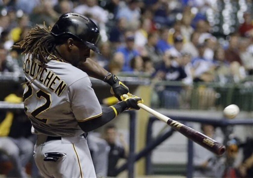 Pittsburgh Pirates' Andrew McCutchen hits a home run during the fifth inning of a baseball game against the Milwaukee Brewers, Wednesday, Sept. 4, 2013, in Milwaukee. (AP Photo/Morry Gash)
