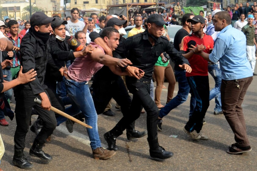Egyptian police arrest a supporter of ousted President Mohamed Morsi during a protest in Cairo in November. Allegations of abuse in Egyptian jails are mounting.