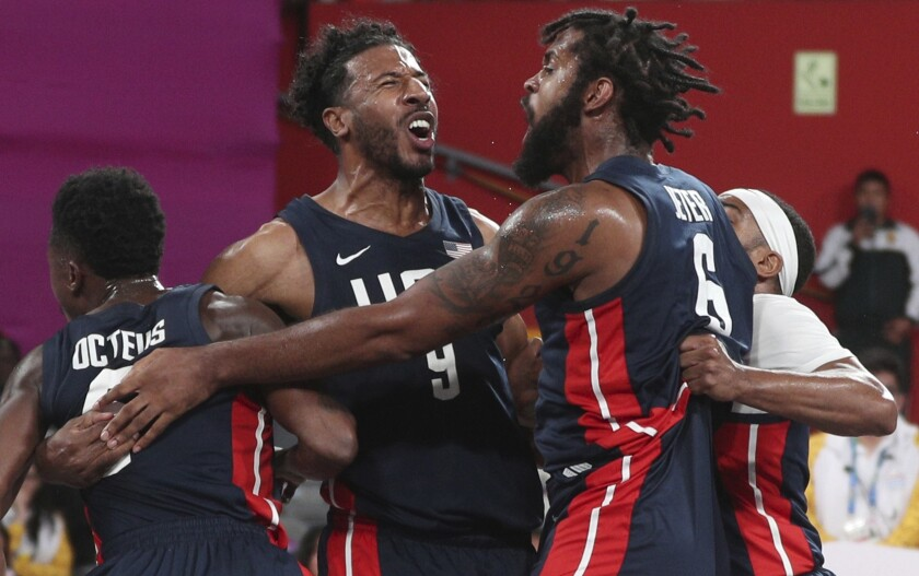 Kareem Maddox, top left, Jonathan Octeus, far left, Sheldon Jeter, top right, and Dominique Jones, far right, celebrate their victory over Puerto Rico after their men's basketball 3x3 final match at the Pan American Games in Lima, Peru on July 29.