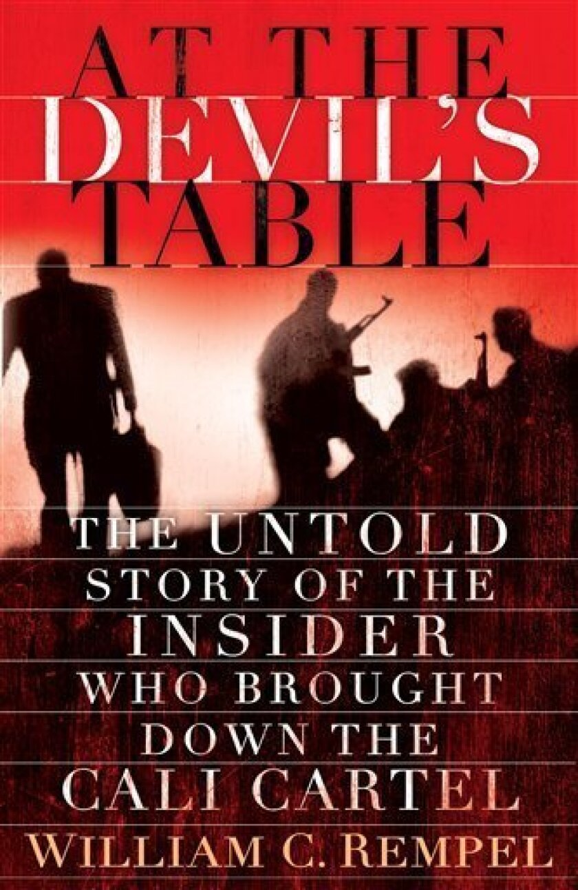 """In this book cover image released by Random House, """"At the Devil's Table: The Untold Story of the Insider Who Brought Down the Cali Cartel,"""" by William C. Rempel, is shown. (AP Photo/Random House)"""