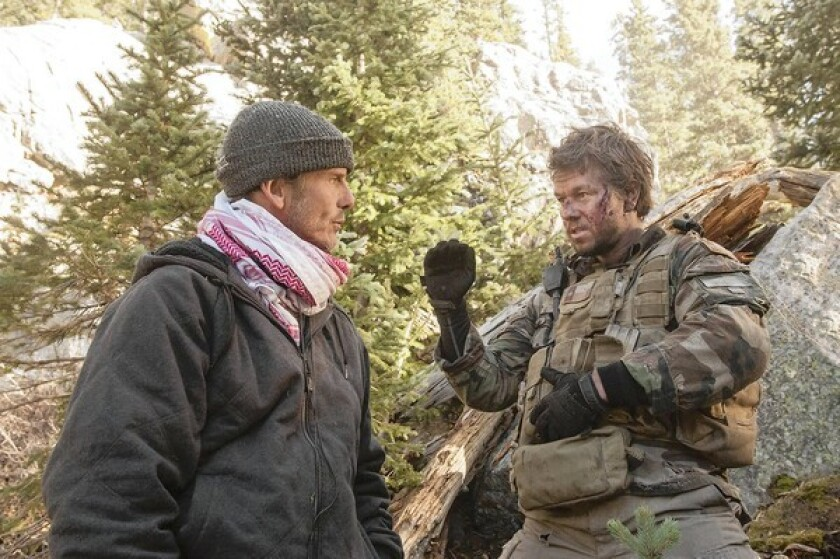 """Director Peter Berg, left, and Mark Wahlberg on the set of the movie """"Lone Survivor."""""""