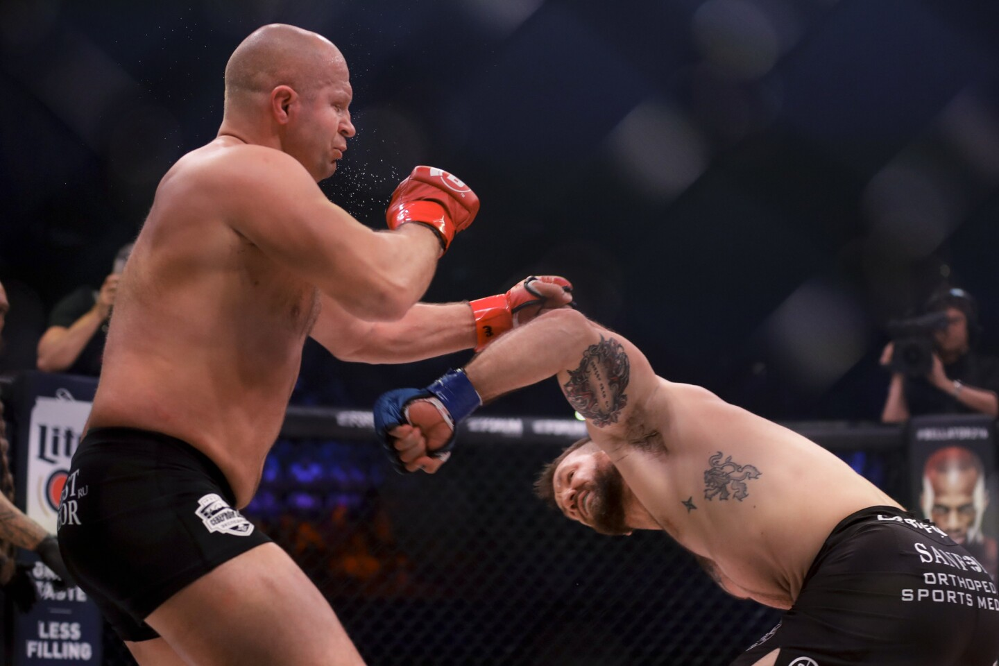 Ryan Bader, right, knocks out Fedora Emelianenko during their mixed martial arts heavyweight world title bout at Bellator 214 on Saturday, Jan. 26, 2019, in Inglewood, Calif. (AP Photo/Chris Carlson)