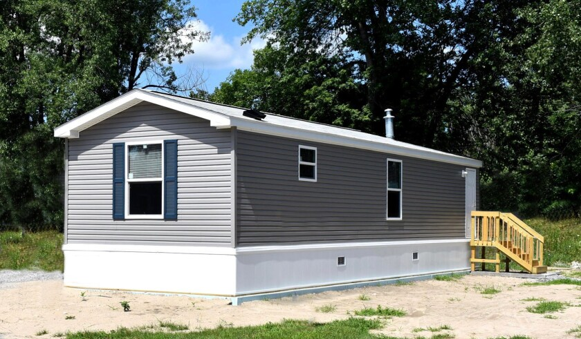 """An example of a """"movable tiny house,"""" a small house on wheels that can be purchased and placed on a property to be used as a detached companion unit."""