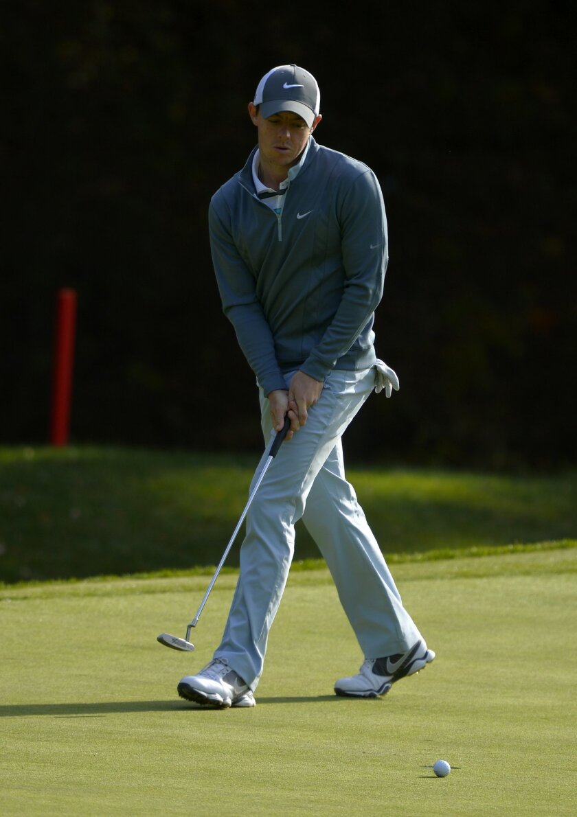 Rory McIlroy, of Northern Ireland, puts on the ninth hole during the final round of the Northwestern Mutual World Challenge golf tournament at Sherwood Country Club, Sunday, Dec. 8, 2013, in Thousand Oaks, Calif. (AP Photo/Mark J. Terrill)