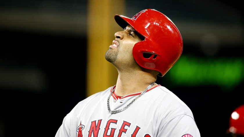 Angels slugger Albert Pujols reacts after grounding out recently, sore foot and all.