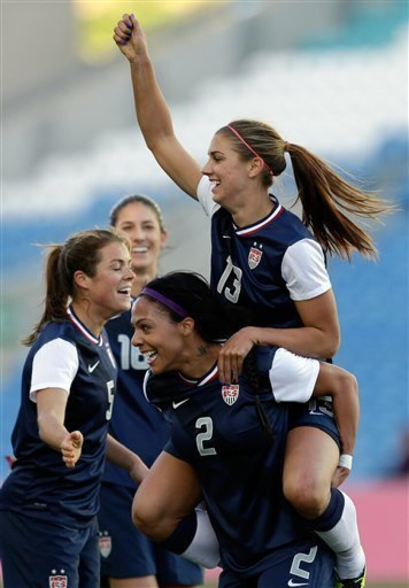 Alex Morgan, of the US celebrates on the back of Sydney Leroux after scoring the opening goal against Germany during their Algarve Cup women's soccer final match Wednesday, March 13 2013, at the Algarve stadium outside Faro, southern Portugal. (AP Photo/Armando Franca)