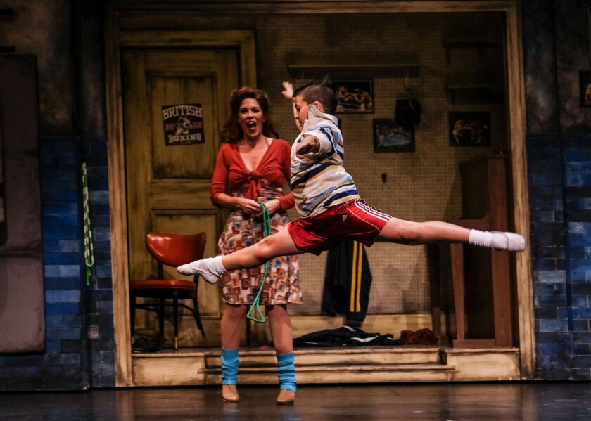 Joy Yandell (Mrs. Wilkinson) and Charlie Garton (Billy Elliot) in San Diego Musical Theater's 'Billy Elliot,' book and lyrics by Lee Hall, music by Elton John, direction by Neil Dale.
