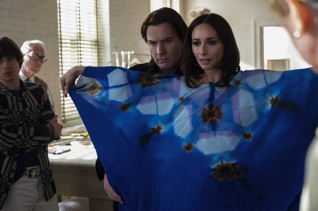"""A model tries on a blue, patterned caftan created by Halston (played by Ewan Gregor)  in a scene from """"Halston."""""""
