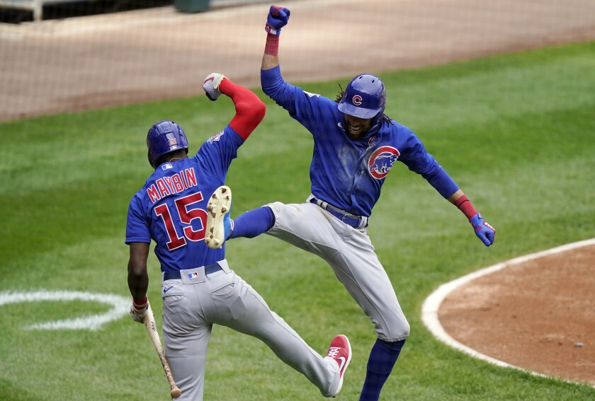 Chicago Cubs' Billy Hamilton, right, celebrates with Cameron Maybin after hitting a solo home run during the fourth inning of a baseball game against the Chicago White Sox in Chicago, Sunday, Sept. 27, 2020. (AP Photo/Nam Y. Huh)