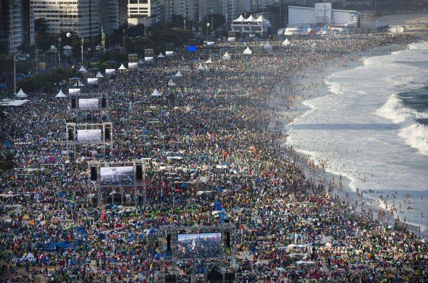 A crowded beach in Copacabana, Brazil. (AP Photo/Felipe Dana)