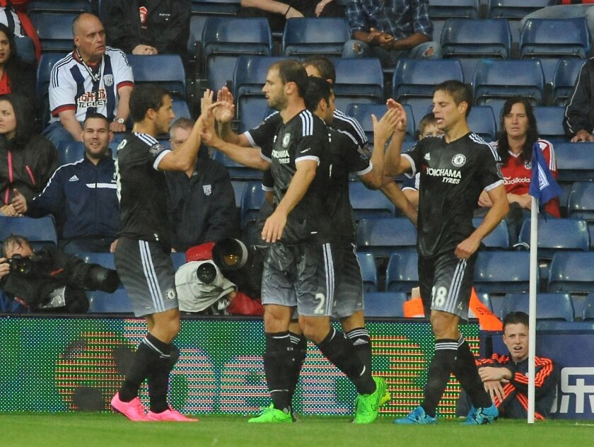 Chelsea players celebrate after Chelsea's Cesar Azpilicueta, right, scored against West Brom during the English Premier League soccer match between West Bromwich Albion and Chelsea at the Hawthorns, West Bromwich, England, Sunday, Aug. 23, 2015. (AP Photo/Rui Vieira)