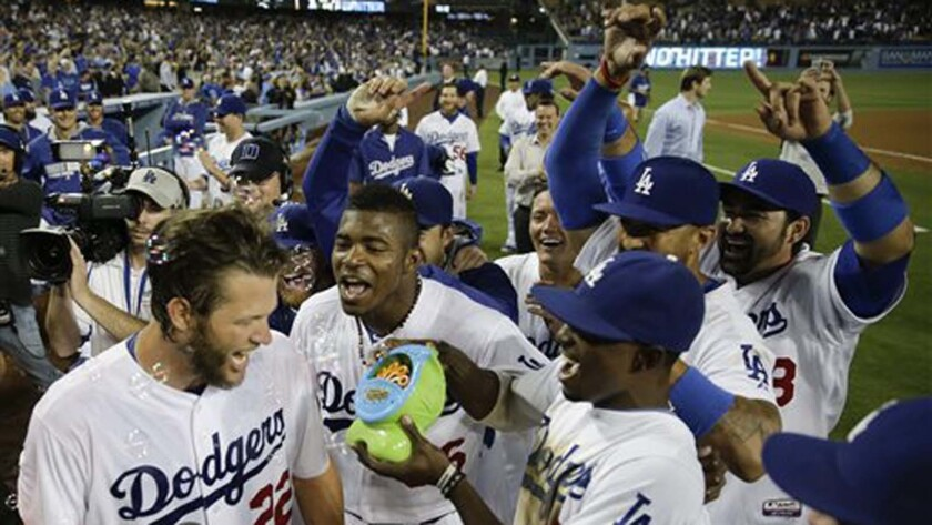 Dodgers ace Clayton Kershaw, left, is mobbed by his teammates after throwing a no-hitter against the