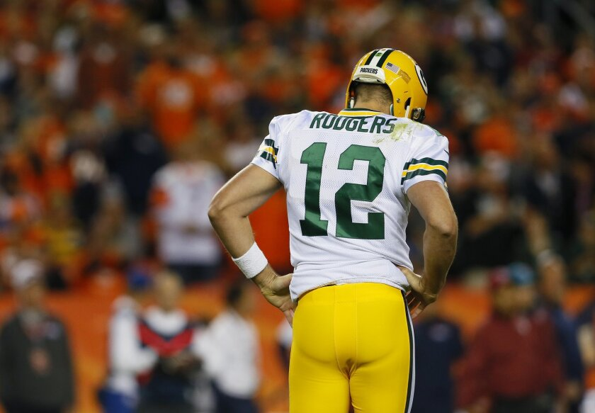 Green Bay Packers quarterback Aaron Rodgers (12) walks to the sidelines against the Denver Broncos during the first half of an NFL football game, Sunday, Nov. 1, 2015, in Denver. (AP Photo/Joe Mahoney)