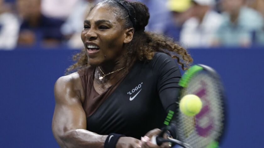 Serena Williams hits a backhand to Karolina Pliskova during the quarterfinals of the U.S. Open on Tuesday in New York.