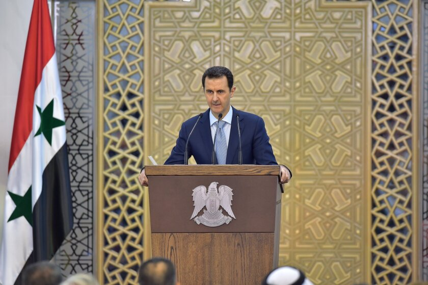 In this photo released by the Syrian official news agency SANA, President Bashar Assad delivers a speech July 26 in Damascus.