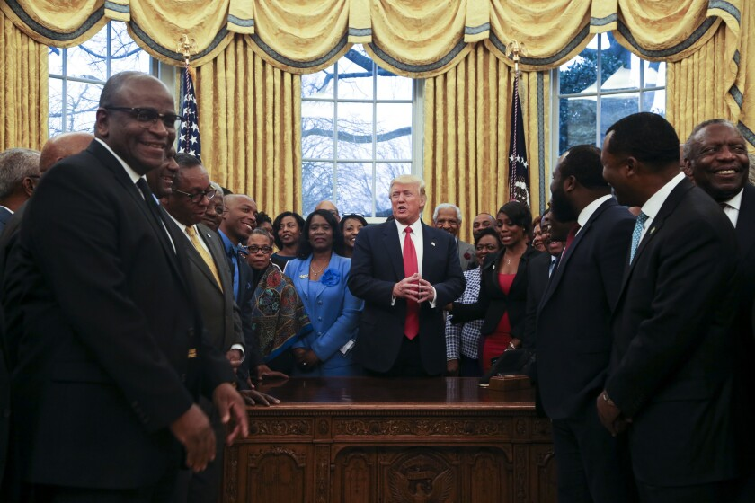 U.S. President Donald Trump poses with the Historically Black Colleges and Universities in the Oval