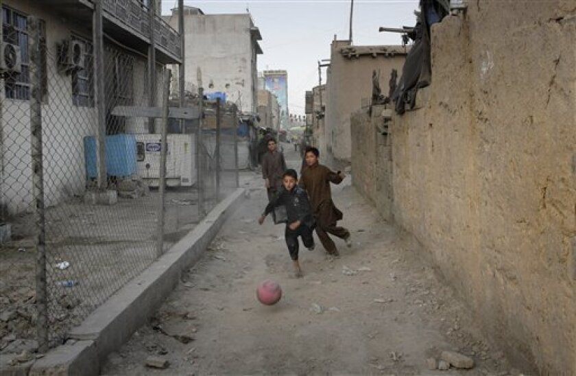 Afghan children play soccer in the old part of the city in Kabul, Afghanistan Wednesday, July 6, 2011. (AP Photo/Musadeq Sadeq)