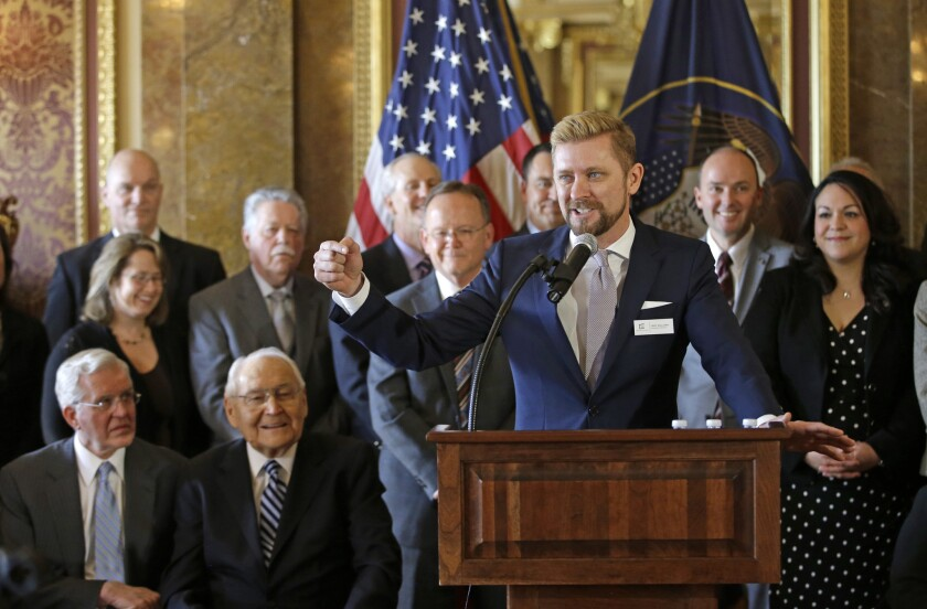 As Mormon leaders and others look on, Equality Utah Executive Director Troy Williams speaks at the Utah Capitol in Salt Lake City after the anti-discrimination bill was introduced this week in the state Senate. The bill was approved Friday on a 23-5 vote.
