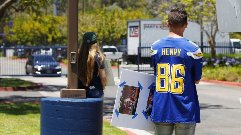 Fan Johnny Olivieri looks on as a moving van pulls into Chargers Park in San Diego after the last Los Angeles Chargers practice in San Diego on June 15, 2017.