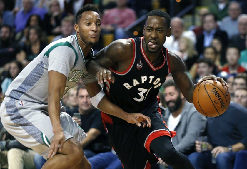Toronto Raptors' Terrence Ross (31) drives past Boston Celtics' Evan Turner (11) during the fourth quarter of an NBA basketball game in Boston, Friday, Oct. 30, 2015. The Raptors won 113-103. (AP Photo/Michael Dwyer)