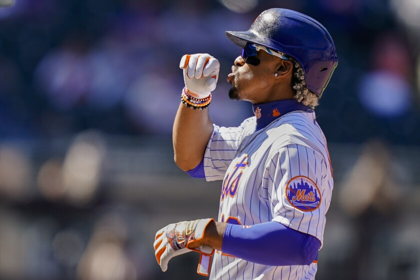 New York Mets' Francisco Lindor reacts after hitting a single off Miami Marlins relief pitcher Nick Neidert during the fifth inning of a baseball game, Thursday, April 8, 2021, in New York. (AP Photo/John Minchillo)