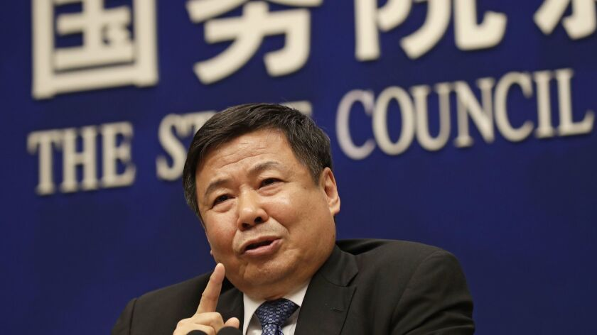 Chinese Finance Vice Minister Zhu Guangyao speaks during a news conference on trade issues at the State Council Information Office in Beijing on April 4.