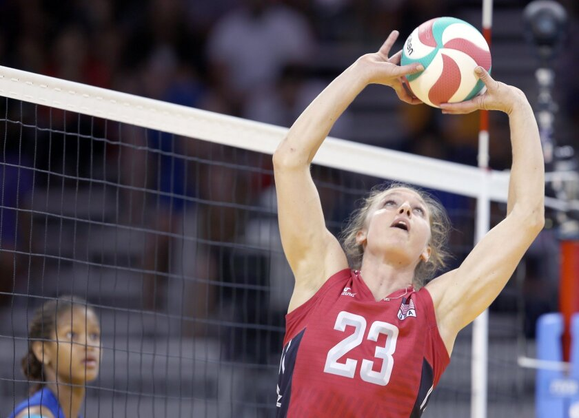 Carli Lloyd, a contender for the U.S. women's Olympic volleyball team, played against Cuba during the Pan American Games last July in Toronto. Lloyd, a setter who attended Fallbrook High School, was named MVP of the team gave the U.S. its first Pan Am gold medal in nearly a half-century. NORCECA
