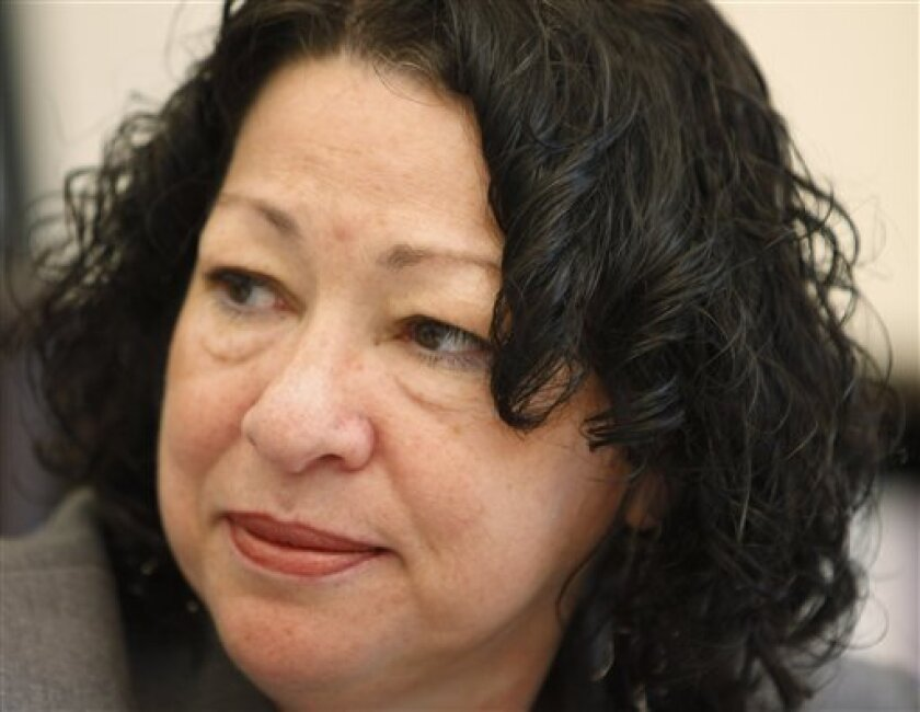 In this Monday, June 1, 2009 file photo, Supreme Court nominee Sonia Sotomayor meets with members of the White House Counsel's office at the Eisenhower Executive Office Building in the White House Complex in Washington. A civil rights group advised by Sotomayor in the 1980's brought several discrimination lawsuits that sought to scrap the results of job tests because too few Hispanics scored highly enough, according to new documents that are fueling GOP criticism of the judge. (AP Photo/Charles Dharapak, File)