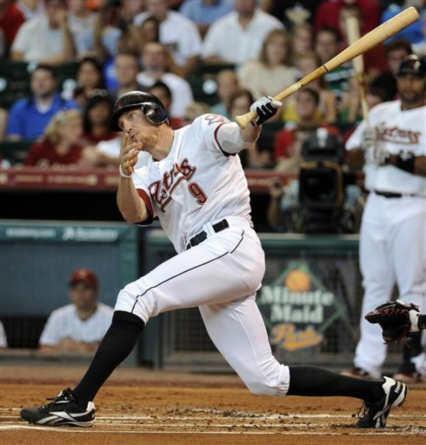 Houston Astros' Hunter Pence hits an RBI-double in the first inning of a baseball game against the Atlanta Braves, Saturday, June 11, 2011, in Houston. (AP Photo/Pat Sullivan)