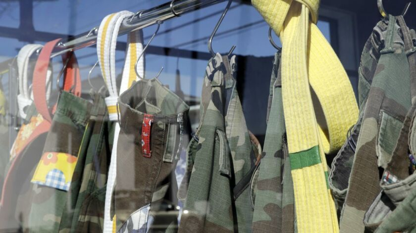 LOS ANGELES, CA-JANUARY 25, 2019: Altered military pants hang in the window of the Atelier & Repairs