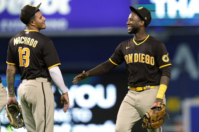Manny Machado and Jurickson Profar celebrate after the Padres victory over the Marlins