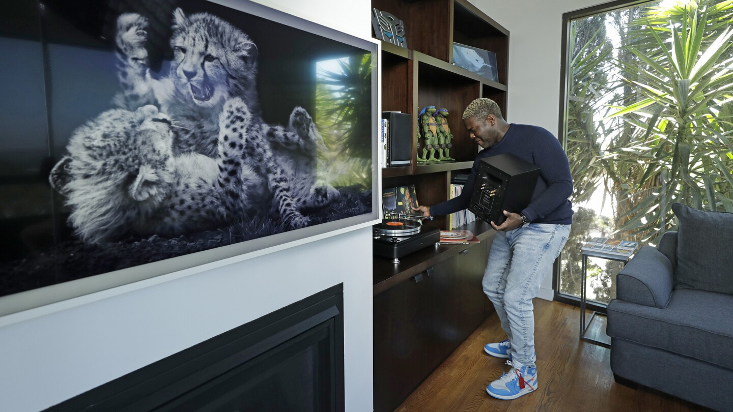 In the den, the actor has a range of collectibles, from Ninja Turtles figures to LPs.