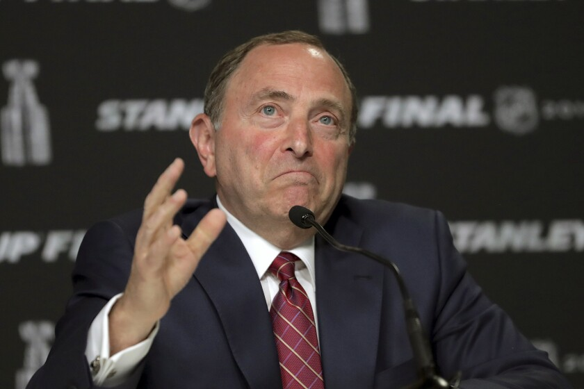NHL Commissioner Gary Bettman speaks during a news conference in June 2019.
